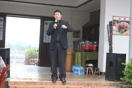 Victor Shu is making a speech of the plans for development in the coming year.