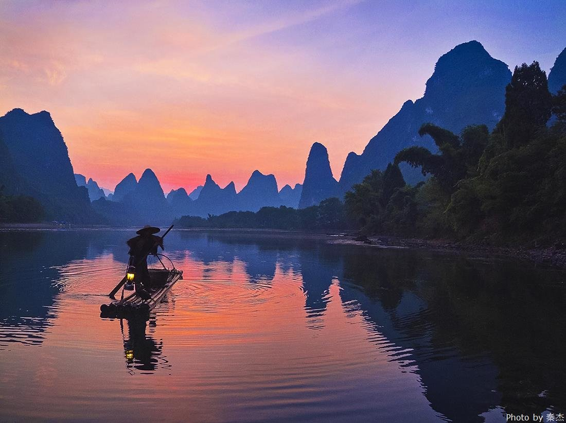 Fishing man on the Li River at dusk