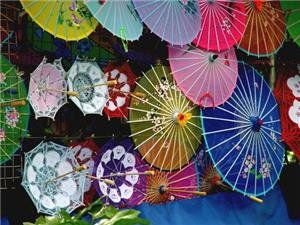 The Colorfully Decorated Almost Gauze Like Chinese Paper Umbrella Is As Quintessentially Chop Sticks Collapsible