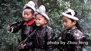 Kids with guns in Basha Miao Village
