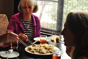 Our customers enjoying Chinese food in a local restaurant