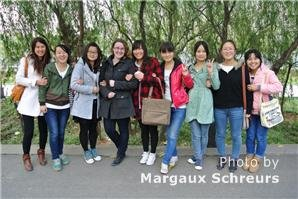 Chinese girls and Western tourist photo