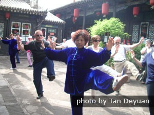 Practice Tai Chi with local master