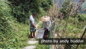 Lele speaks dialect to a rice terrace farmer