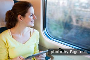 woman on train with tablet