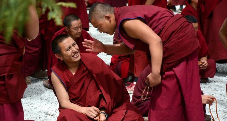 debates between monks with red dress