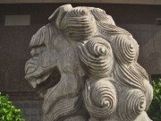 Single-knotted mane stone lion face