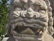 No pupils and pointed tongue stone lion face