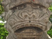 Frowning monkey-like stone lion face