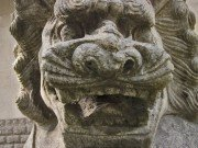 More dragon-like stone lion face