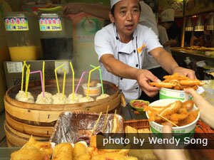 Enjoy local snacks at the City God Temple