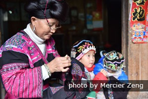 A Yao woman in Longji is embroidering