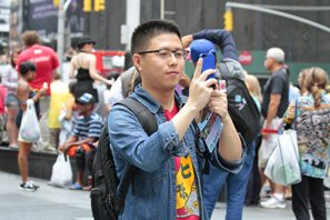 Asian man using smartphone