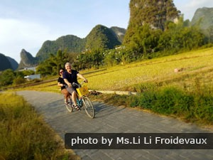 Ride a bike to see the view of countryside in Yangshuo.