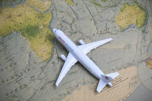 model passenger aircraft on a world map