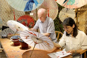 Painting on a paper umbrella