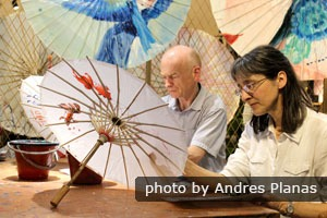 China Highlights customers making painted paper umbrellas in Hangzhou