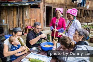 China Highlights customers making bamboo tube rice at Longji