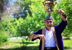 Uyghur man dancing with a vessel on his head