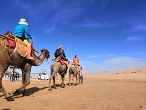 Ride a camel in Dunhuang