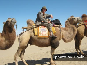 Riding a camel in Dunhuang