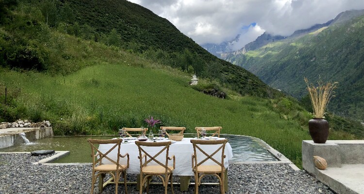table with the view of the green mountains