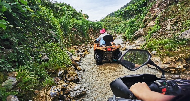 Drive an ATV in a stream
