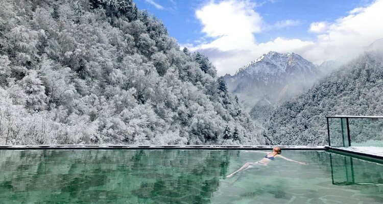 Soak in a hot spring in snow world