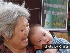 Chinese grandma and infant grandson