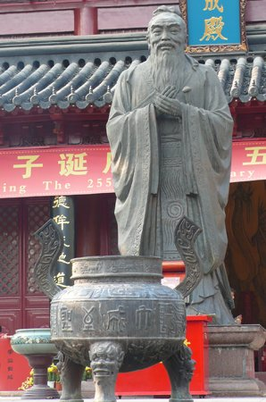 Confucius statue with an incense burner at a Confucius temple