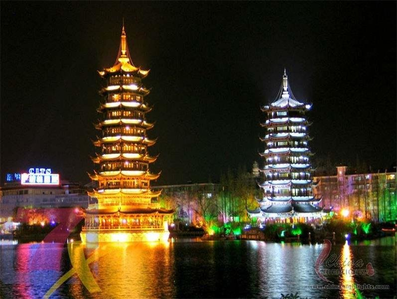 Two towers in the center of Shan Lake at night
