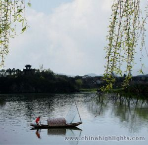 "In Jiangwan town, there is the ""Late Dragon Mount"" full of trees and the river with flowing water."