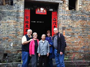 tourists and local outside old house in China